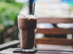 Close up of a glass of Iced Cocoa cool drink served on table.