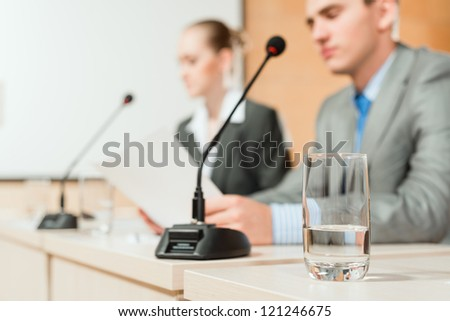 close-up of a glass of water, the business conference