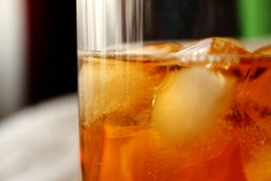 Close up of a glass with Rooibos icetea