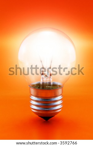 close-up of a glowing light bulb on a red background