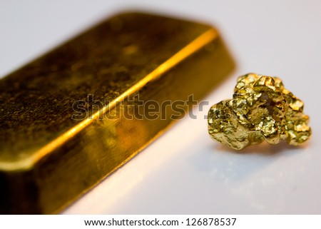 Close-up of a gold-bar and gold-nugget