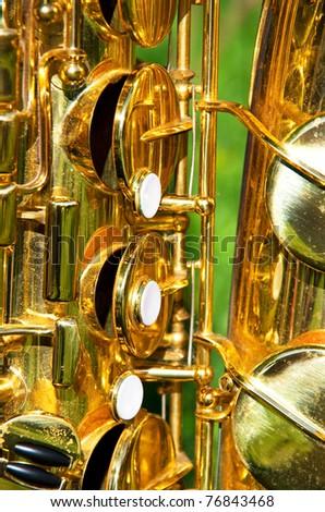 close-up of a golden brass saxophone with sun light effects