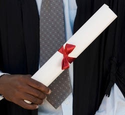 Close-up of a graduate holding a diploma