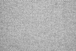 Close-up of a gray textured fabric. Macro shot of gray upholstery for furniture. Wallpaper and background. Closeup grey fabric texture. Thick gray material for the interior.