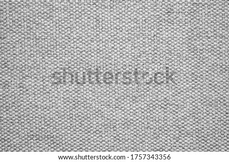Close-up of a gray textured fabric. Macro shot of gray upholstery for furniture. Wallpaper and background. Closeup grey fabric texture. Thick gray material for the interior. Stock foto ©