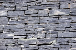 Close up of a gray Welsh slate wall.  Decorative stone abstract background.