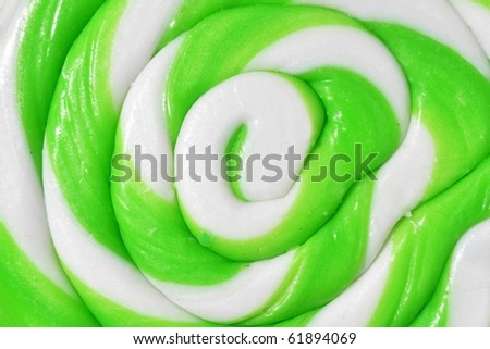 Close up of a green and white lollipop. Useful as a background pattern.