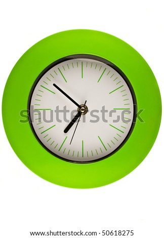 Close-up of a green clock on white