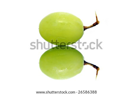 Close up of a green grapes isolated over white background.