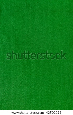 Close-up of a green poker table felt surface