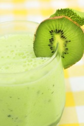 Close up of a green smoothie with fresh kiwi
