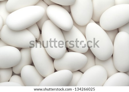 close up of a group of white sugared almonds