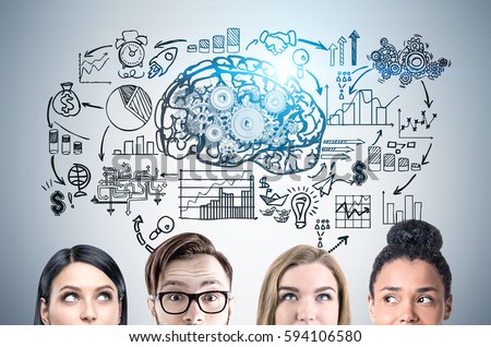 Close up of a group of young business people standing near a gray wall with a brain and gears sketch and a startup sketch drawing on it. Toned image