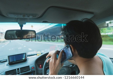 Close up of a guy talking on the phone in the car. #1216660144