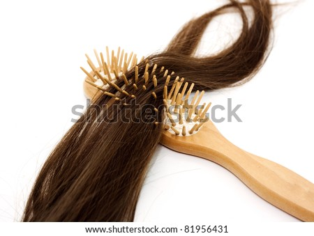 Close-up of a hairbrush with lost hair in it isolated on white.