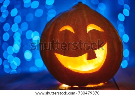 Close up of a Halloween pumpkin jack face lantern with candle light copyspace tradition autumn celebration scary spooky concept. #730479370