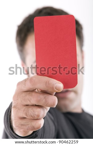 Close up of a hand holding a red card