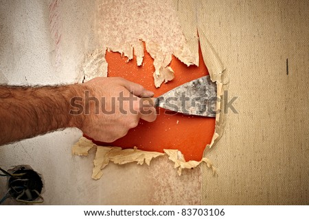 close up of a hand holding a spatula for renovation