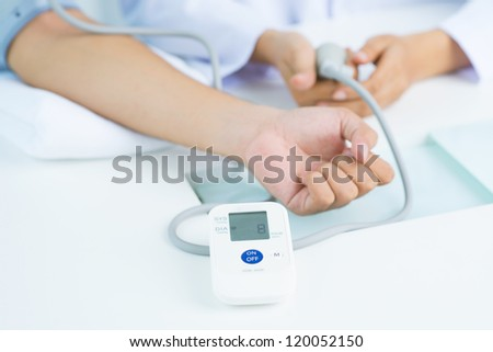 Close-up of a hand in blood pressure gauge