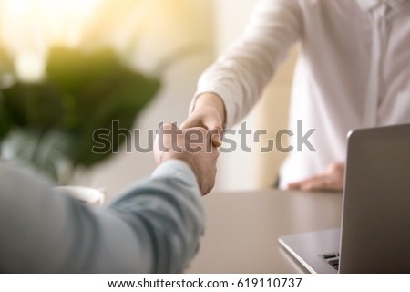 close up of a handshake  male...