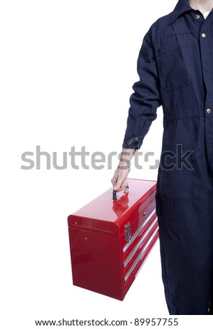 close up of a handyman in blue coveralls with a bright red toolbox