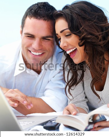 stock photo : Close up of a happy young couple looking at laptop