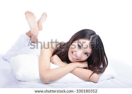 Close up of a happy young woman smile looking at something interesting while lying on the bed, isolated on white background , model is a asian girl