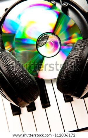 Close up of a headphone and cd on a synth