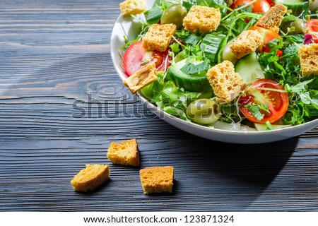 Close-up of a healthy chicken salad with croutons