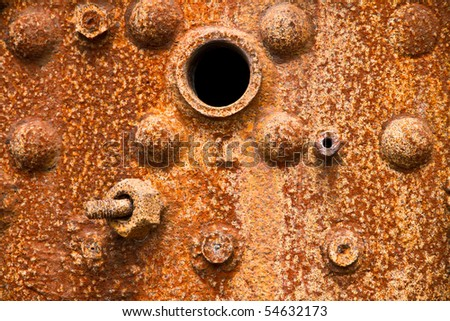 Close up of a heavily corroded old steam boiler