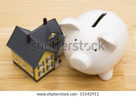 Close up of a home with a piggy bank