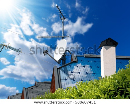 Close-up of a house roof with solar panels and satellite dish with antenna TV,  on a blue sky with clouds, sun rays and a power line #588607451