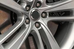 close up of a hub cap of a jaguar auto mobile