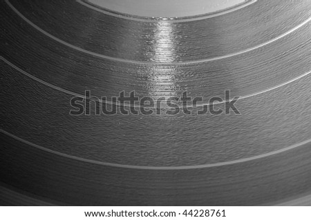 Close up of a 12 inch vinyl music LP record disc.