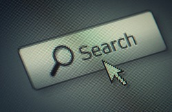 Close-up of a interface computer search button and an arrow mouse cursor
