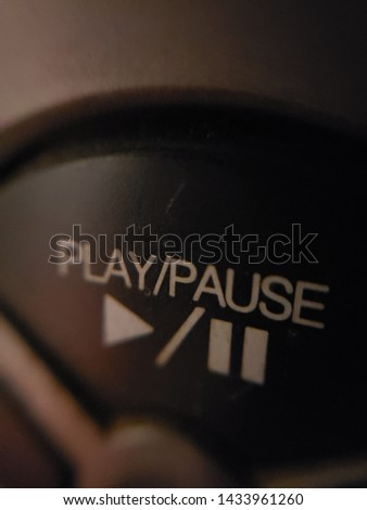 Close-up of a karaoke play/pause button. #1433961260