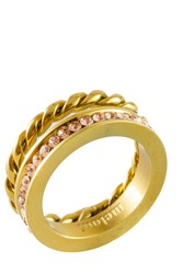 Close-up of a knotted sparkly twin golden ring with zircons isolated on white background