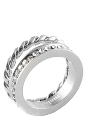 Close-up of a knotted sparkly twin silver ring with zircons isolated on white background