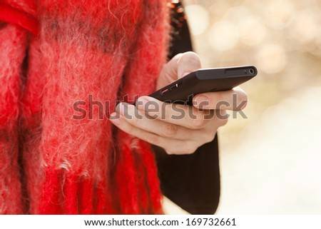 Close up of a lady using mobile smart phone