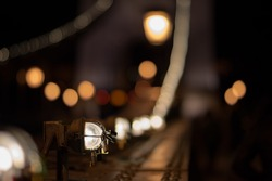 Close up of a lamp on the Budapest Chain Bridge against a defocused background