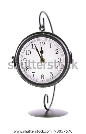 Close-up of a large clock on the stand. Isolated on white background