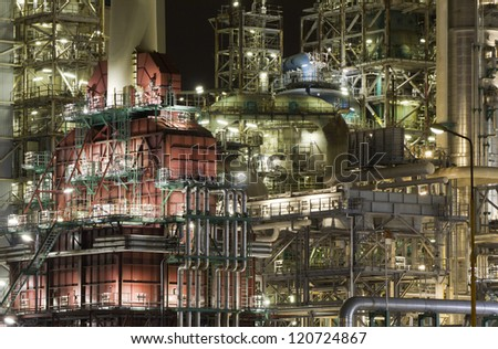 Close-up of a large oil-refinery plant at night