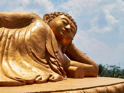 Close up of a large sleeping buddha statue in Central Java, Indonesia