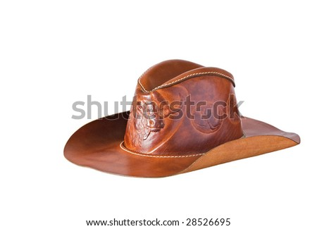 Close-up of a leather cowboy hat against a white background - stock photo
