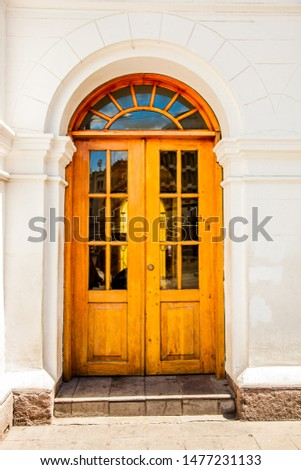 Close-up of a light brown wooden door with semi-modern rustic design. #1477231133