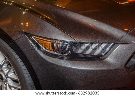 Close-up of a lighthouse on a large black sports car #632982035