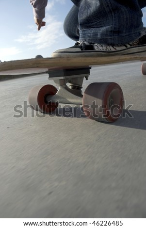 Close-up of a longboard skating past on the promenade