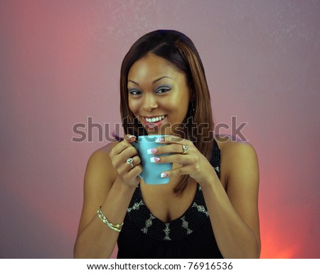 Close-up of a lovely teen with a captivating smile, holding a cup of coffee or hot tea.