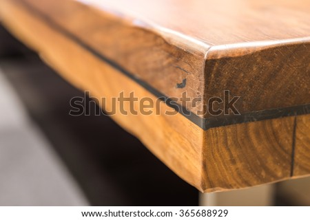 Close-up of a luxurious table corner , vintage solid wood furniture detail