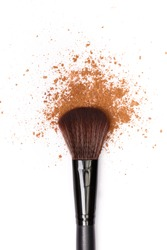 close up of a make up powder and a brush. makeup brush with powder foundation isolated on white